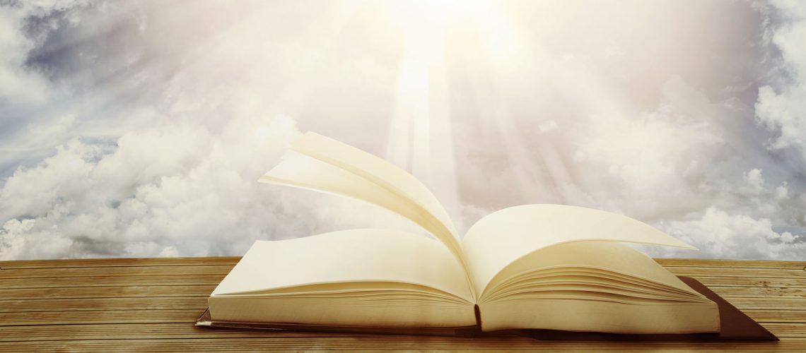 Open book in front of sky